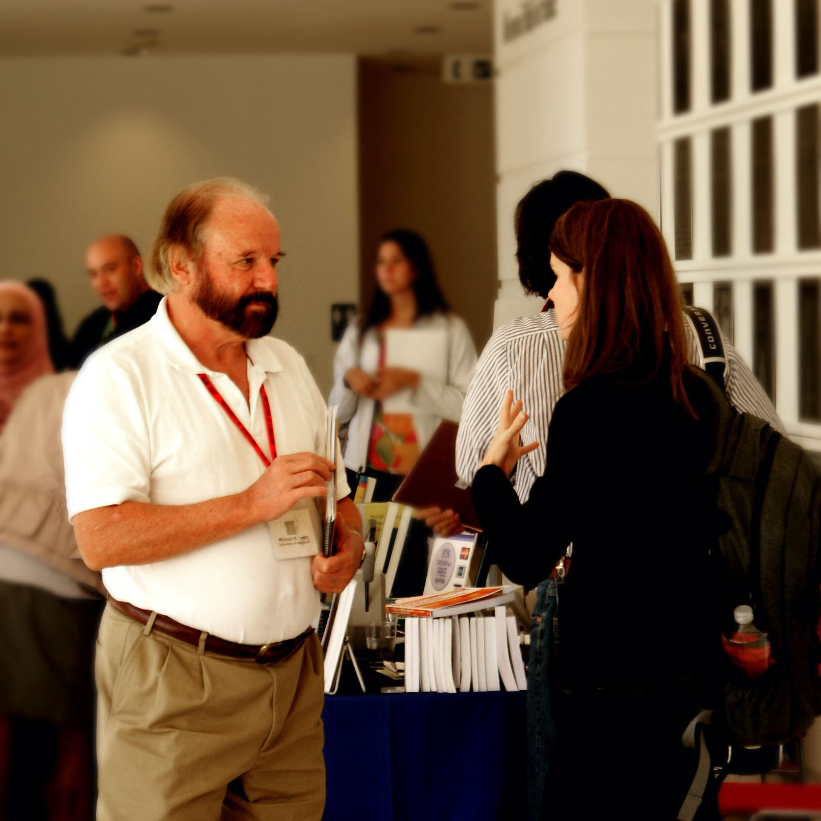 Mike long talking with someone at the Second Language Research Forum conference in 2010