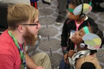 Chris Heffner with children at AAAS Family Science Days.